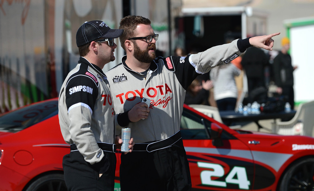 """. Rosamond, Calif., -- 03-23-13-  Toyota Pro/ Celebrity Race participants Olympic gold medalist simmer Tyler Clary,left, and co-host of \""""Top Gear \"""" Rutledge Wood, talk stratagy during a practice session at Willow Springs Raceway. The Toyota Pro/Celebrity Race helps raise money on behalf of Racing for Kids, a fundraising program benefiting Miller Children�s Hospital in Long Beach and Children�s Hospital of Orange County. On behalf of the race and its participants, Toyota has donated more than $2 million to various children�s hospitals since 1991.  Stephen Carr/  Los Angeles Newspaper Group"""