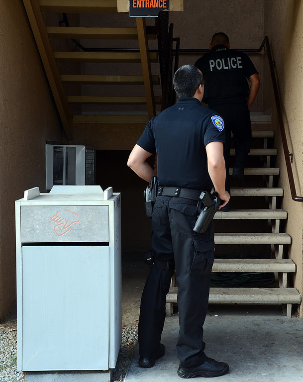 . Federal drug agents, San Bernardino police officers and code enforcement officers fanned out across the city Wednesday, raiding a chain of medical marijuana dispensaries and a private residence, police said. Rick Sforza/Staff Photographer