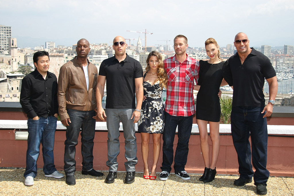 ". Left to right, Justin Lin, Tyrese Gibson, Vin Diesel, Elsa Pataky, Paul Walker, Gal Gadot and Dwayne Johnson pose during a photocall to promote the film ""Fast and Furious\"", in Marseille, southern France, Thursday, April 28, 2011. (AP Photo/Claude Paris)"