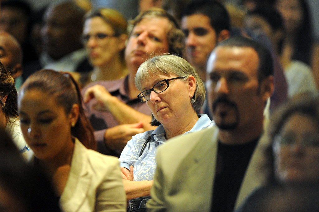. Peter Lee, director of Covered California discusses the states efforts to implement the Affordable Care Act during a town hall meeting at CSULB  in Long Beach, CA on Friday, September 6, 2013. A full house of people listen to Lee and try to get answers to the way health care will work in the near future. (Photo by Scott Varley, Press-Telegram)