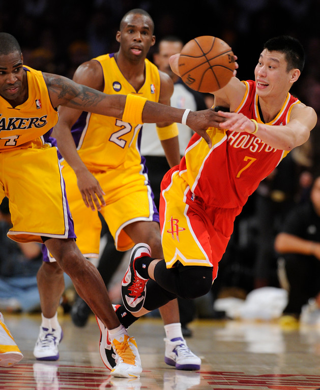 . Rockets#7 Jeremy Lin digs out a loose ball in the 4th quarter/ The Lakers defeated the Houston Rockets in overtime 99-95 in the final home game of the year at Staples Center in Los Angeles, CA 4/17/2013(John McCoy/Staff Photographer