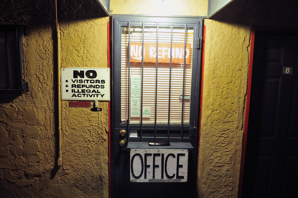 . Rules of the El Capitan Motor Inn are posted outside the office door.Photo by Thomas Wasper for the Press Telegram