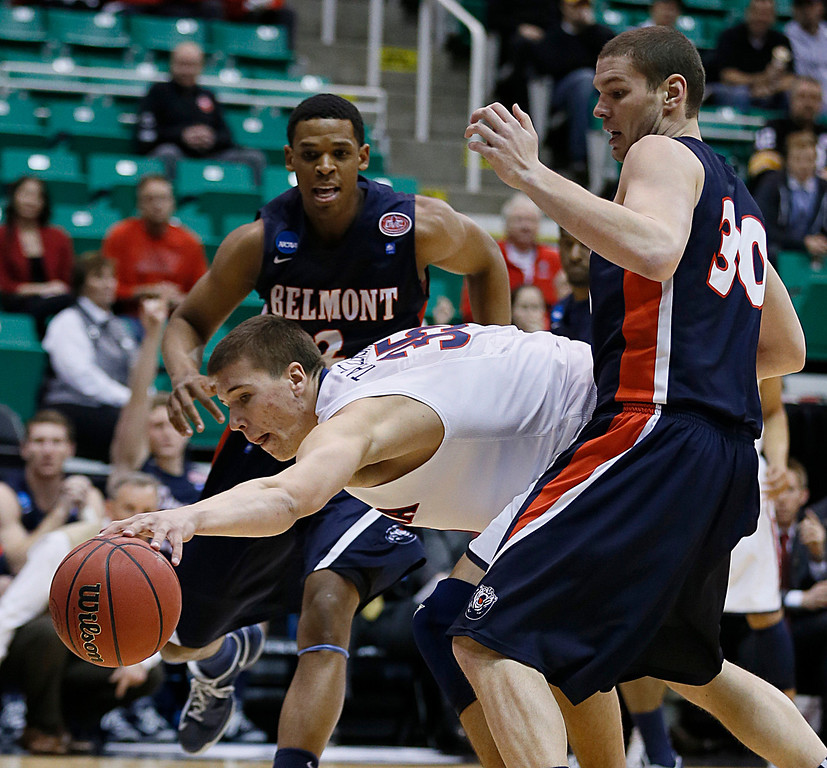 . Arizona\'s Kaleb Tarczewski, center, grabs the ball as Belmont\'s Blake Jenkins, left, and Trevor Noack look on during the first half of a second-round game in the NCAA college basketball tournament in Salt Lake City Thursday, March 21, 2013. (AP Photo/George Frey)