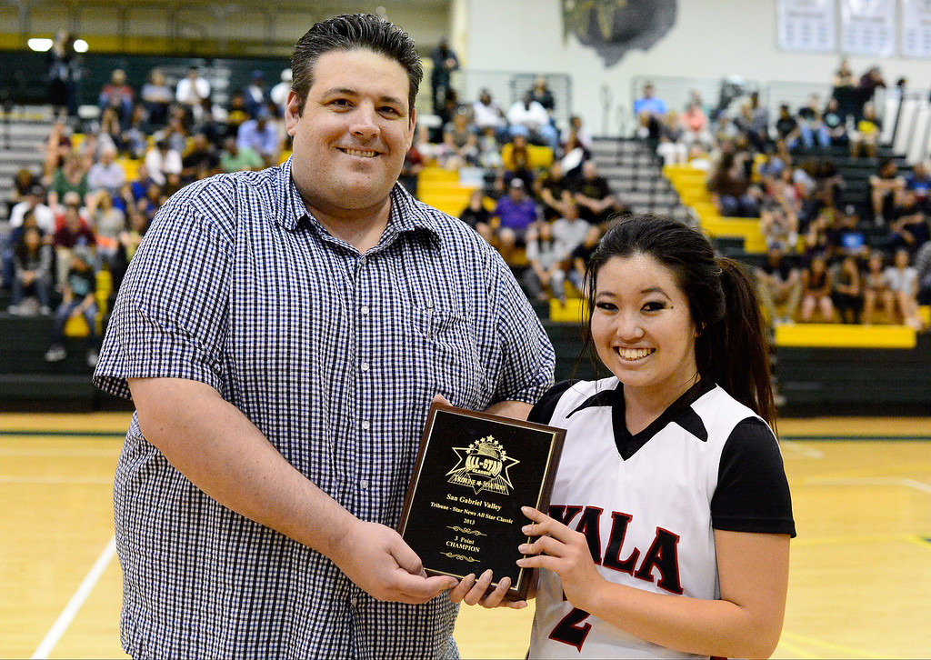 . Pasadena Star-News reporter Aram Tolegian hands out a shooter award to Ayala\'s Kristi Sakamoto during the 10th annual Tribune/Star-News boys/girls basketball all-star classic Friday night, April 26, 2013 at Damien High School in La Verne. (SGVN/Staff Photo by Sarah Reingewirtz)