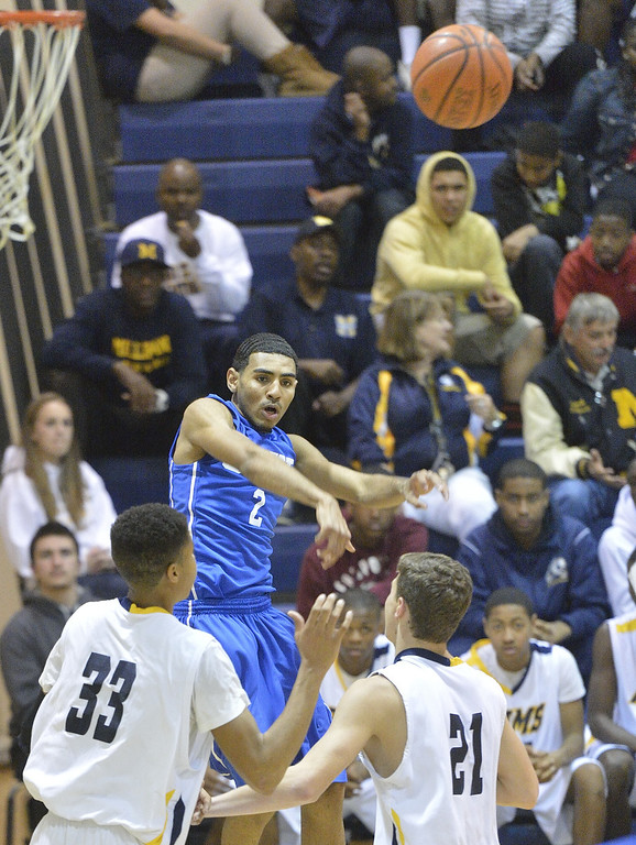 . LONG BEACH, CALIF. USA -- Gahr\'s Malachi Hoosein (2) passes over Millikan\'s Malik Marquetti (33) and Jacob Lundi-Mallett (21) during their CIF-SS Divison 1-A playoff game in Long Beach on February 15, 2013. Millikan defeated Gahr, 74 to 64. Photo by Jeff Gritchen / Los Angeles Newspaper Group