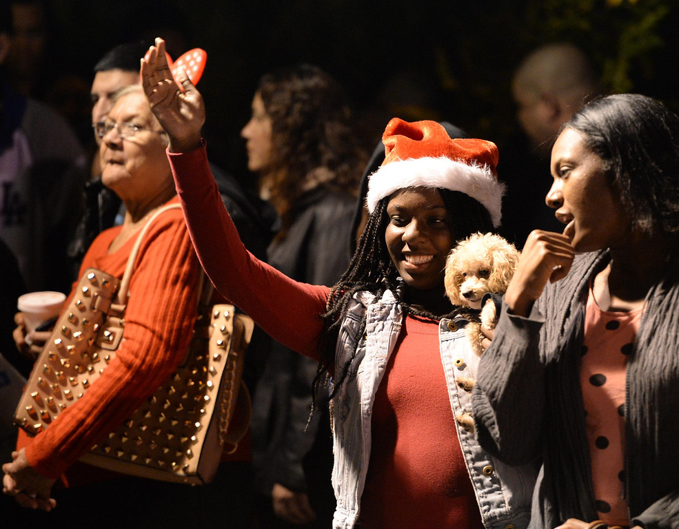 . The 60th annual Daisy Avenue Parade in the Wrigley neighborhood Saturday, December 13, 2013, in Long Beach, CA.   People wave to the passing parade. Photo by Steve McCrank/DailyBreeze