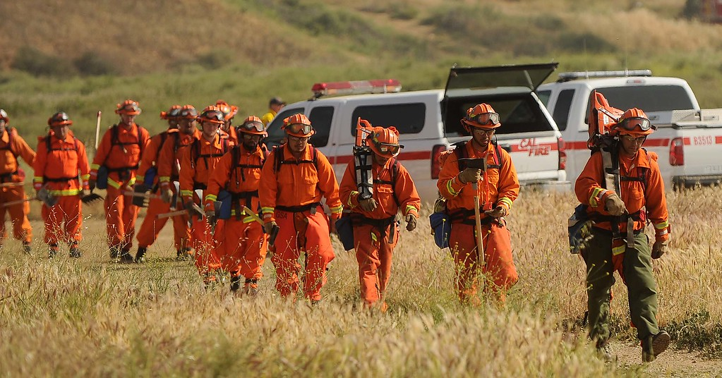 Description of . (4-23-13)--FONTANA-METRO--Cal Fire inmates from Fenner Canyon Fire Crew hike during exercises training on their time Tuesday April 23, 2013  off Lytle Creek Road in Fontana. Cal Fire inmate fire crews are participating in two days of fire preparedness exercises on timed hike, fire shelter deployment, progressive hose lay and hand line construction. LaFonzo Carter/Staff Photographer