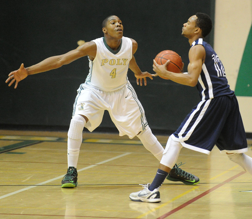 . 02-19-2012--(LANG Staff Photo by Sean Hiller)- Mayfair at Poly in the second round of the Division I-AA boys basketball playoffs Tuesday night. Mayfair\'s Jarrod Sheffield looks to pass away from Poly\'s Chris Sullivan.