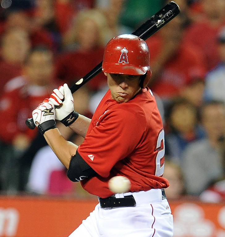 . Los Angeles Angels\' Peter Bourjos watches a baseball pass by in the sixth inning of a spring baseball game against the Los Angeles Dodgers on Thursday, March 28, 2012 in Anaheim, Calif.   (Keith Birmingham/Pasadena Star-News)