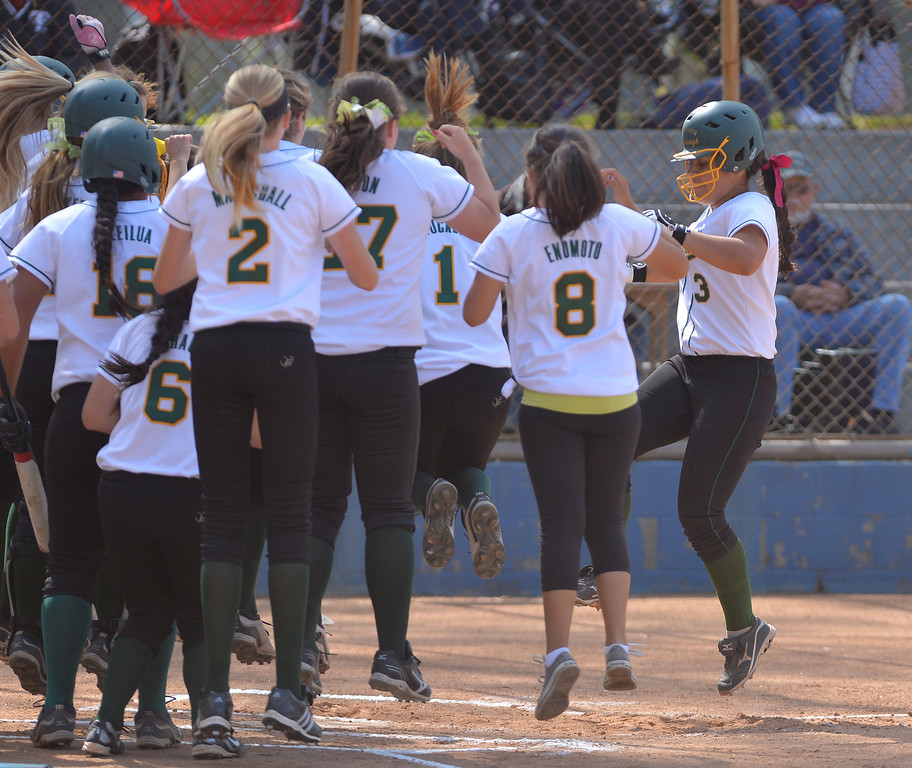 . 0517_SPT_TDB-L-MC-TORRANCE--- Torrance, CA--5/16/13--- Staff Photo: Robert Casillas  - Daily Breeze / LANG--- Mira Costa defeated Torrance High 7-1 in CIF DIV III softball playoff game at Wilson Park in Torrance. Mira Costa\'s Brittany Werre (3) jumps into pile of players at home after she hit a two-run homer in 2nd inning.