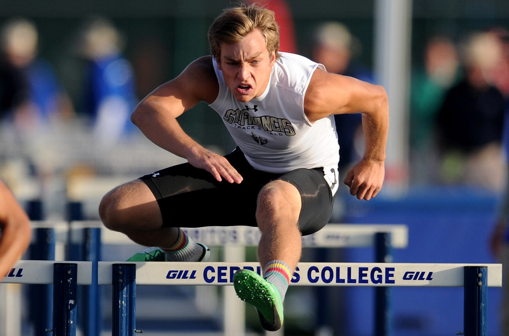 . St. Francis\'s Caleb Simmeth in the 110 hurdles during the CIF-SS Masters Meet at Cerritos College on Friday, May 24, 2013 in Norwalk, Calif.  (Keith Birmingham Pasadena Star-News)