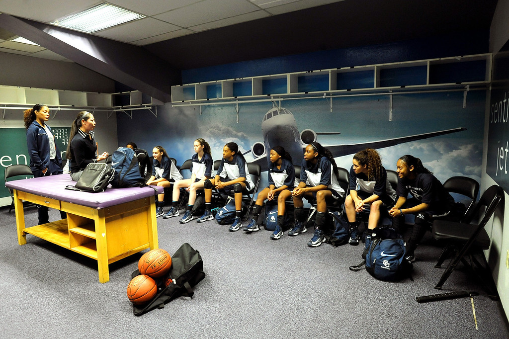 . Sierra Canyon girls basketball head coach Alicia Komaki talks to her team prior to the start of their game against Pinewood High School during the 2013 CIF State Basketball Championships at the Sleep Train Arena, in Sacramento, Ca March 22, 2013.(Andy Holzman/Los Angeles Daily News)