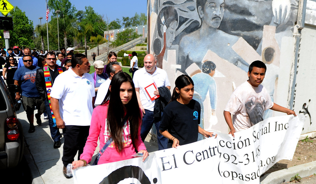 . Locals march for peach during the El Centro de Accion Social is hosting its Annual Cesar Chavez Commemoration and Peace Walk at the Villa-Parke Community Center on Saturday, March 30, 2013 in Pasadena, Calif.  (Keith Birmingham Pasadena Star-News)