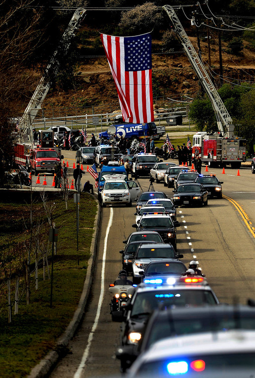 Description of . The procession for San Bernardino County Sheriff Deputy Jeremiah MacKay travels along Glen Helen Parkway on its way to the San Manuel Amphitheater in Devore February 21, 2013.  The procession was 13-miles long and stretched from San Bernardino, to Fontana, to Devore.  GABRIEL LUIS ACOSTA/STAFF PHOTOGRAPHER.