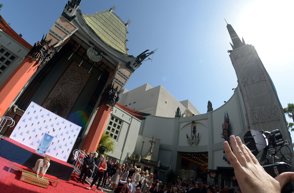 . Actress Jane Fonda prints her hands in wet cement during her Handprint/Footprint Ceremony during the 2013 TCM Classic Film Festival at TCL Chinese Theatre on April 27, 2013 in Los Angeles. Fonda is an American actress, writer, political activist, former fashion model, and fitness guru. She rose to fame in the 1960s with films such as Barbarella and Cat Ballou. She has won two Academy Awards, an Emmy Award, three Golden Globes and received several other movie awards and nominations during more than 50 years as an actress. After 15 years of retirement, she returned to film in 2005 with Monster-in-Law, followed by Georgia Rule two years later. She also produced and starred in over 20 exercise videos released between 1982 and 1995, and once again in 2010.   AFP PHOTO/JOE KLAMAR        (Photo credit should read JOE KLAMAR/AFP/Getty Images)