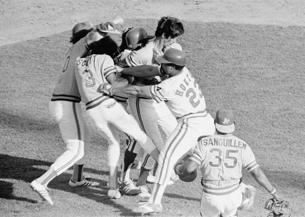. Texas Ranger designated hitter, Willie Horton (23), slugs Oakland Athletics second baseman, Rodney Scott (3), in a brawl between Texas Ranger third baseman, Toby Harrah and Oaklands pitcher, Jim Umbarger in the third inning of play Monday, August 9, 1977, Arlington, Tex. Oaklands Wayne Gross, far left, gets in on the action as they surround Unbarger at Arlington Stadium in the first game of a double header. Oaklands designated hitter, Manny Sanguillen (35), far right, runs onto the field to help. The Texas Rangers went on to win the contest 5-2. (AP Photo)