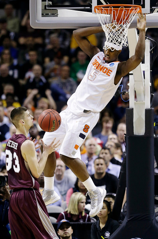. Syracuse forward C.J. Fair (5) dunks over Montana forward Mike Weisner (33) during the first half of a second-round game in the NCAA college basketball tournament in San Jose, Calif., Thursday, March 21, 2013. (AP Photo/Jeff Chiu)