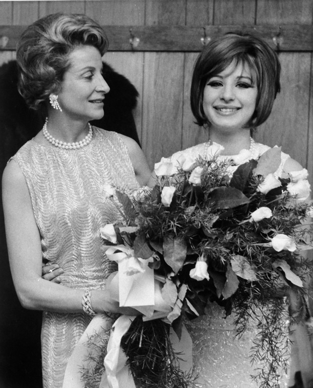 ". Barbra Streisand, right, star of ""Funny Girl\"" which opened in Boston on January 13, 1964 receives a bouquet from Frances Brice, daughter of the late musical comedy star Fanny Brice.   The musical is about the early career of Fanny Brice.  Fran Brice is married to Hollywood producer Ray Stark.   (AP Photo)"