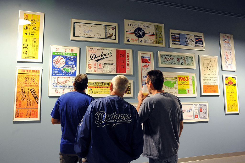 . Fans look at framed Los Angeles Dodger tickets on opening day at Dodger Stadium April 1, 2013.  The Dodgers hosted the San Francisco Giants.(Andy Holzman/Staff Photographer)