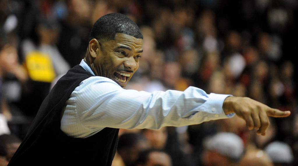 . 02-26-2012--(LANG Staff Photo by Sean Hiller)-Etiwanda beat Long Beach Poly 59-55 in Tuesday\'s CIF Southern Section Division 1AA semifinal boys basketball game at Long Beach Poly High School. Poly Coach  Sharrief Metoyer gets fired up on the sideline.
