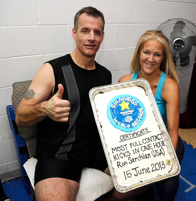 . Actor/stuntman Ron Sarchian and Diane Klein pose together with a cake as Ron set a new Guinness world record by full contact kicking a bag 6,000 times in one hour and did it by 6,012 at the Martial Arts History Museum in Burbank. 