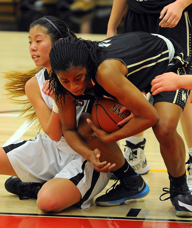 . STUDIO CITY - 02/16/13 - (Photo: Scott Varley, Los Angeles Newspaper Group)  CIF Southern Section Division IV-AA second-round girls basketball playoff game. Bishop Montgomery vs Harvard-Westlake. Bishop Montgomery won 57-42. BM\'s Chelsea Lidy scoops up a loose ball from Teeana Cotangco.