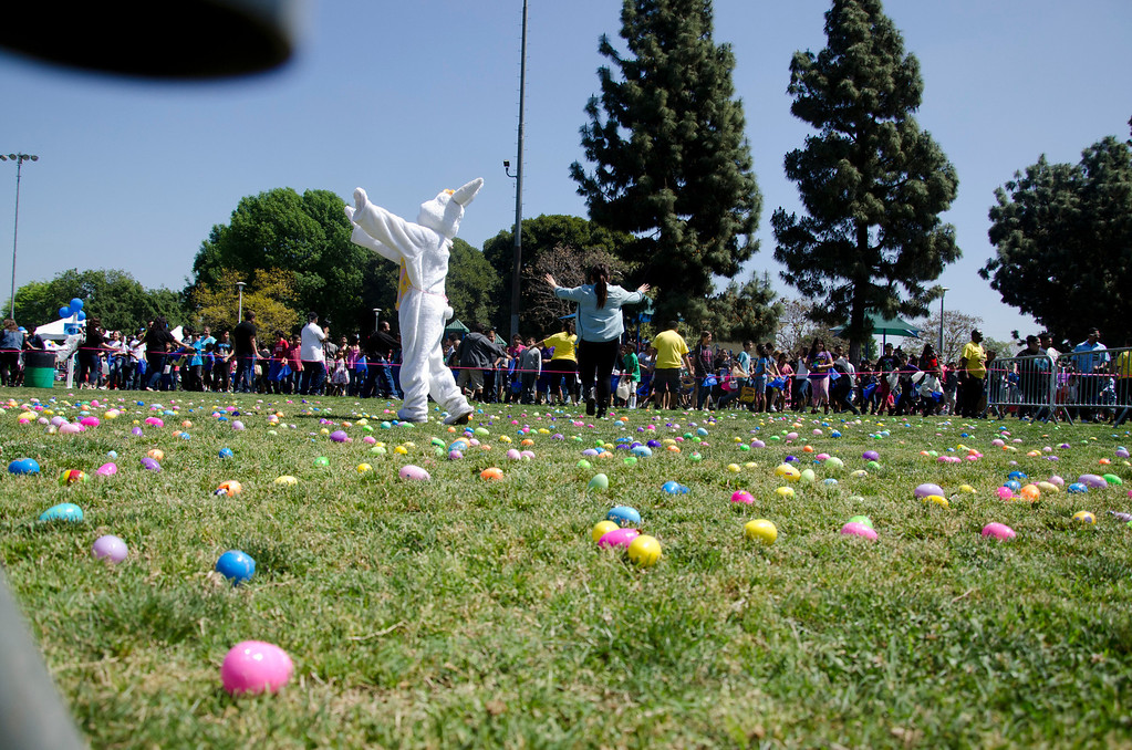 Description of . Volunteers try to control a crowd of children at Easter Land, hosted by Los Angeles County Parks and Recreation and Freedom Christian Center at Mayberry Park in South Whittier, Calif., Saturday, March 20, 2013. An expected crowd of 2,000 guest more than doubled for a helicopter drop of 5,000 Easter eggs. (SGVN/Correspondent photo by Anibal Ortiz)