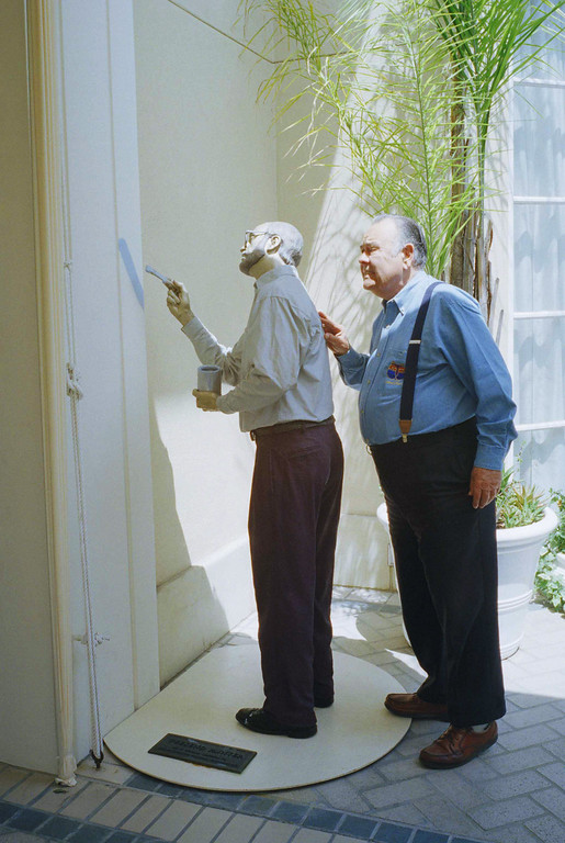 ". Comedian Jonathan Winters asks: \'\'Are you finished\'\'? as he takes a tour around a look-a-live garden statue ""Weekend Painter,\"" by J. Seward Johnson Jr., at a Beverly Hills hotel on Monday, May 6, 1997. (AP Photo/Damian Dovarganes)"