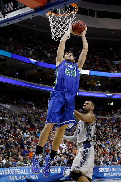 . Florida Gulf Coast\'s Chase Fieler dunks against Georgetown\'s Jabril Trawick during the second half of a second-round game of the NCAA college basketball tournament on Friday, March 22, 2013, in Philadelphia. (AP Photo/Matt Rourke)