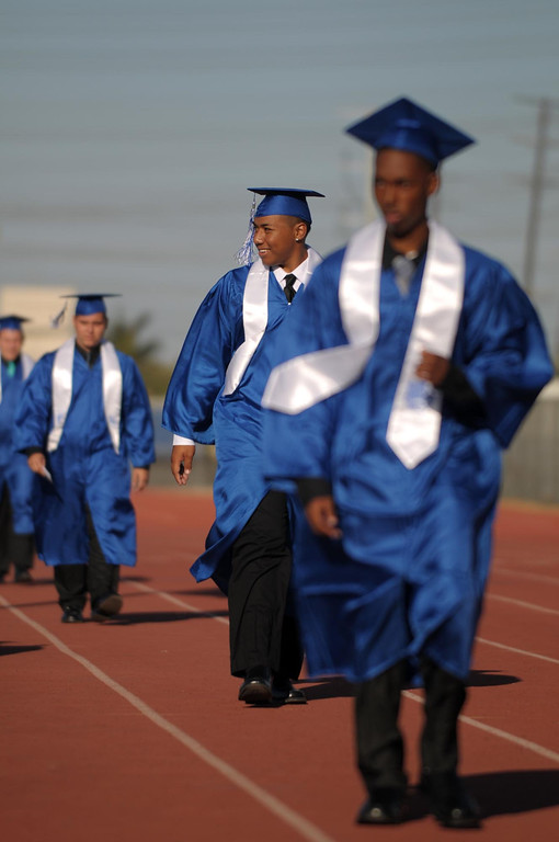 . Jose Gomez walks to receive his diploma. The 2013 North High School commencement ceremonies take place on the school\'s football field in Torrance Wednesday afternoon.