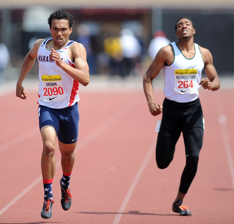 Description of . Maranatha's Kyle Brown, left, won the 400 meters race as Bonita's Devin Rutherford, right, finished fourth during the Arcadia Invitational at Arcadia High School on Saturday, April 6, 2013 in Arcadia, Calif.  (Keith Birmingham Pasadena Star-News)