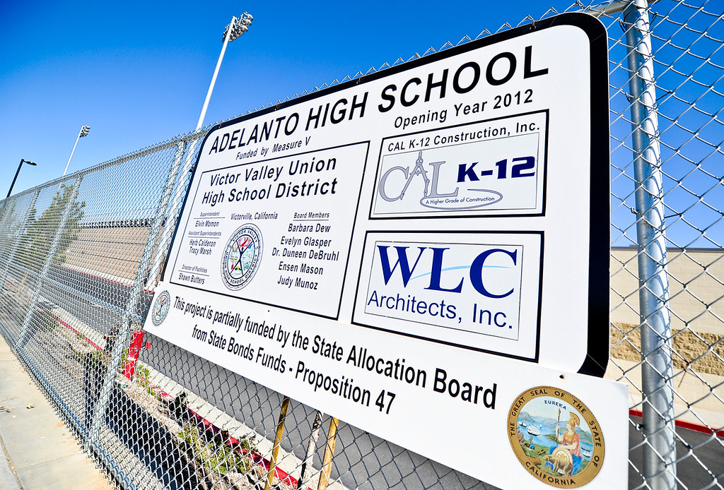 Description of . Victor Valley Union High School District's brand new campus Adelanto High School remains unused and locked behind fences in Adelanto on Friday, April 19, 2013. The district decided Thursday to keep Adelanto High School closed through the 2014-2014 school year to due unavailable funds to open the school, and in the meantime, students continue to attend overcrowded high schools in Victorville. (Rachel Luna / Staff Photographer)