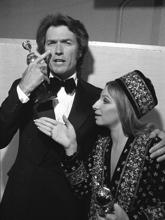 . Clint Eastwood and Barbra Streisand are shown after winning Golden Globes in Los Angeles, Feb. 5, 1971.  (AP Photo)