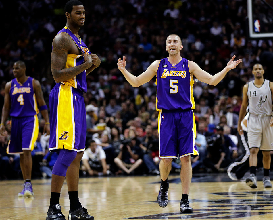 . Los Angeles Lakers\' Steve Blake (5) reacts to a call during the second half of Game 1 of their first-round NBA basketball playoff series against the San Antonio Spurs, Sunday, April 21, 2013, in San Antonio. San Antonio won 91-79. (AP Photo/Eric Gay)
