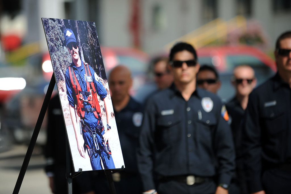 . A photograph of firefighter Jeff Langley is displayed during a 20th Anniversary Memorial Ceremony for him March 28, 2013 at the Los Angeles County Fire Department Barton Heliport in Pacoima, CA.  Langley was killed during a 1993 Air Operations rescue in Malibu.(Andy Holzman/Staff Photographer)