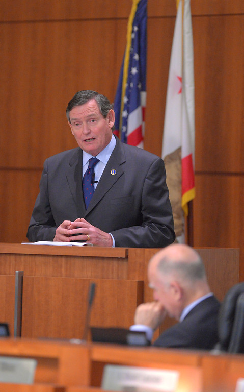 . Gov. Jerry Brown, foreground, listens as CSU Chancellor Timothy P. White gives his State of the CSU address in Long Beach, CA on Wednesday, January 29, 2014. (Photo by Scott Varley, Daily Breeze)
