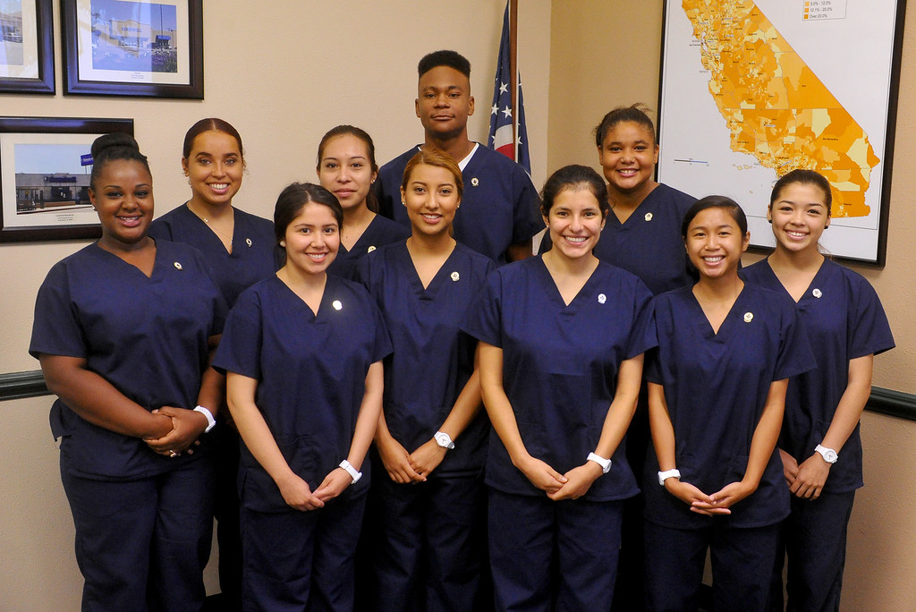 . 10 recent high school graduates received their Certified Nursing Assistant certificates at the Goodwill in Long Beach, CA on Friday, August 22, 2014. The students; Gabriela Avila, Averianna Burnett, Alesia Clay, Ariana Mays, Kendra Montano, Silvia Monzon, Genesis Perez, Cindia Sanchez, Daniel Scott and Dahlia You completed the year-long course in a partnership between the LBUSD and Goodwill. This is the first year that the state Certified Nurse Assistant Training Academy program has been free for the students. It was announced to the families and friends gathered that all 10 of the graduates have health care job interviews next week. (Photo by Scott Varley, Daily Breeze)