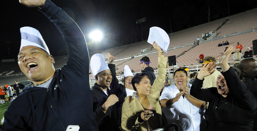 Description of . Students from Le Cordon Bleu College of Culinary Arts react after winning the lego car race competition during the the 2013 Collegiate Field Tournament at the Rose Bowl on Friday, April 5, 2013 in Pasadena, Calif.  (Keith Birmingham Pasadena Star-News)