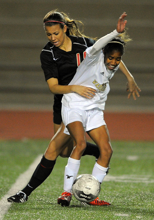 . TORRANCE - 02/12/2013 - (Staff Photo: Scott Varley/LANG) West High girls soccer beat Murrieta Valley on penalty kicks in their CIF Southern Section Division II wild-card matchup. After a 0-0 tie, West won 3-1 on PKs. MV\'s Lauren Palmer, left, received a yellow card for this play on West\'s Zoe Anderson.