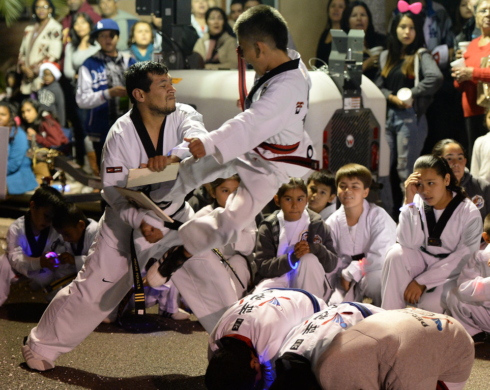 . The 60th annual Daisy Avenue Parade in the Wrigley neighborhood Saturday, December 13, 2013, in Long Beach, CA.   Peralta\'s Tae Kwon Do puts on a demonstration. Photo by Steve McCrank/DailyBreeze