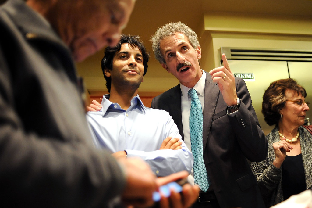 . City Attorney candidate Mike Feuer watches election results with Manav Kumar during his election night party in Los Angeles, CA March 5, 2013.(Andy Holzman/Los Angeles Daily News)