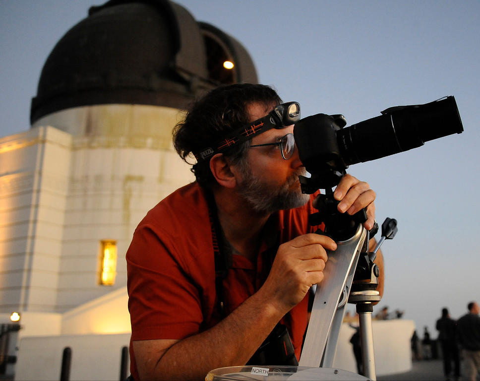 Description of . David Beraru, from Woodland Hills, lines up his camera to photograph the comet Pan-STARRS.  The comet will be visible through the end of March.
