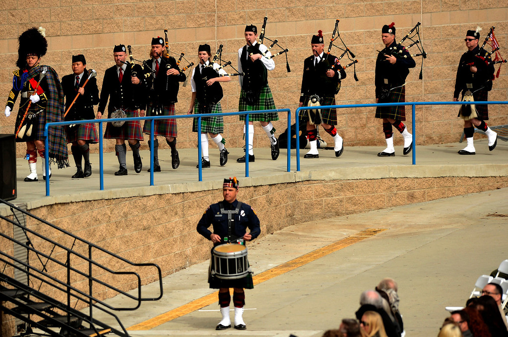 Description of . Bag pipers perform at memorial services for San Bernardino County Sheriff Deputy Jeremiah MacKay at the San Manuel Amphitheater in Devore February 21, 2013.  GABRIEL LUIS ACOSTA/STAFF PHOTOGRAPHER.