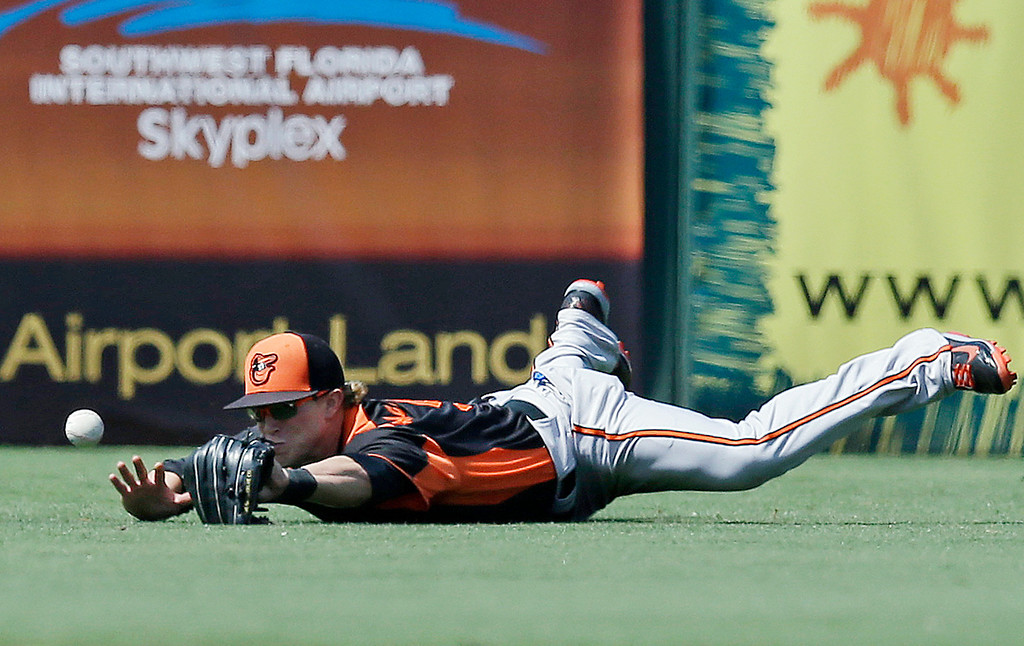 Description of . Baltimore Orioles left fielder Nate McLouth dives but can't handle a double by Minnesota Twins' Chris Parmelee in the fifth inning of an exhibition spring training baseball game in Fort Myers, Fla., Tuesday, March 26, 2013. (AP Photo/Elise Amendola)