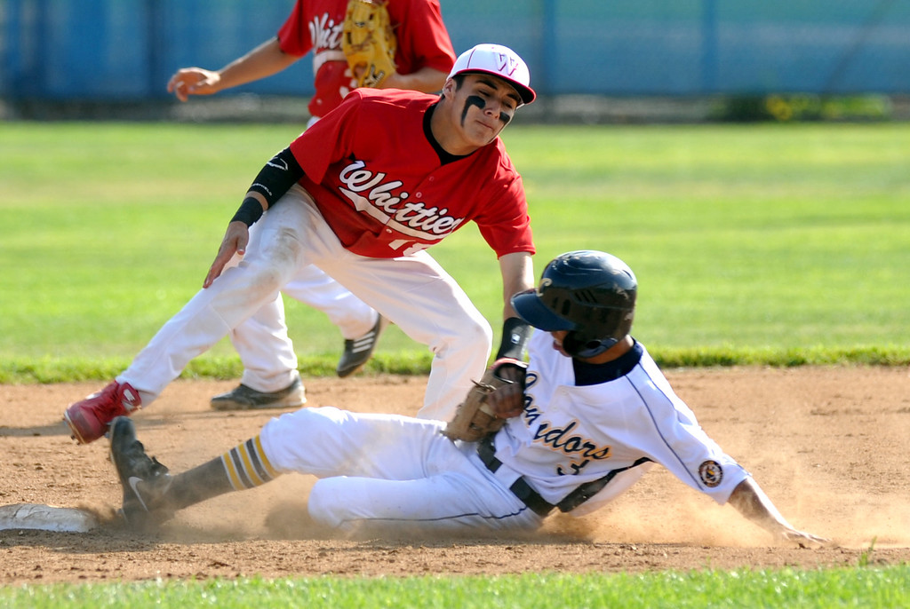 . Whittier shortstop Tommy Estrella (#18) tags out California\'s Dominick Rodriguez (#3) trying to steal second base in their Del Rio League game at California High School in Whittier on Friday March 22, 2013. California beat Whittier 6-0. (SGVN/Staff Photo by Keith Durflinger)