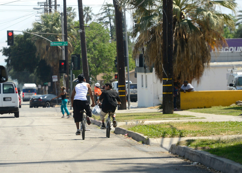 . Some youth ride bikes along the 1200 block of North Sierra Way towards Baseline Street in San Bernardino April 22, 2013.   GABRIEL LUIS ACOSTA/STAFF PHOTOGRAPHER.