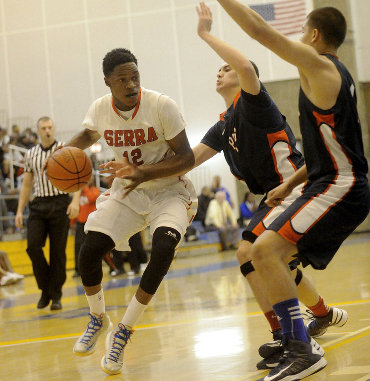 . 03-12-2013--(LANG Staff Photo by Sean Hiller)-Serra\'s Tavrion Dawson (12) drived against Pacific Hills\' Adam Palx (2), center, and Jonathon Mills (1) in Tuesday\'s boys basketball IV Southern California Regional semifinal at L.A. Southwest College.