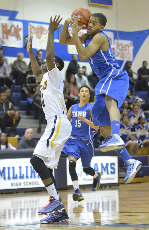 . LONG BEACH, CALIF. USA -- Millikan\'s Brian Chambers (0) and Gahr\'s Chudi Ibe (11) during their CIF-SS Divison 1-A playoff game in Long Beach on February 15, 2013. Millikan defeated Gahr, 74 to 64. Photo by Jeff Gritchen / Los Angeles Newspaper Group