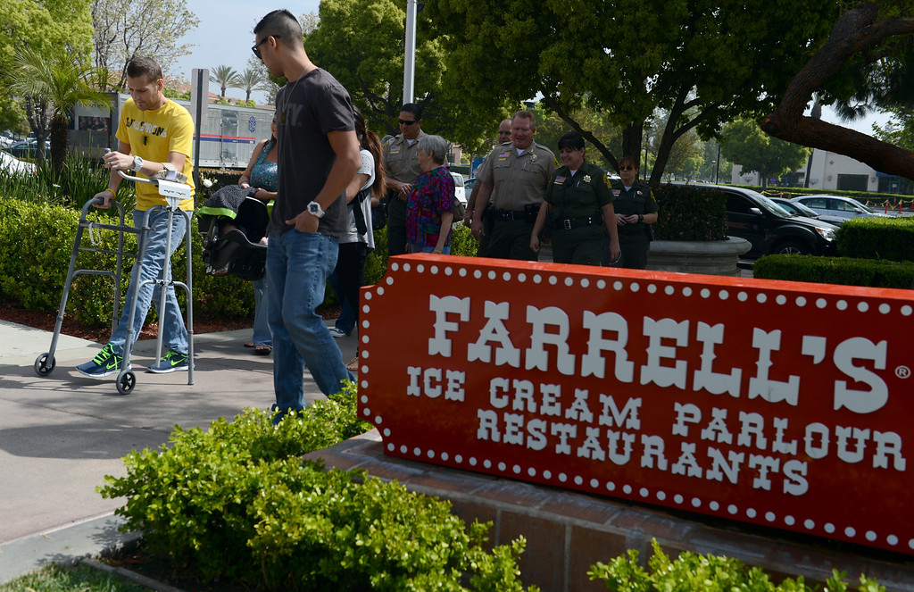 . Farrell\'s CEO Mike Fleming presents a check to SEAT for $10,000 Thursday, April 4, 2013, at Farrell\'s Ice Cream Parlour in Rancho Cucamonga. The money is being donated through the Riverside Police Officer Association and the Sheriff\'s Employee Assistance Team to help the families of police officers shot by Christopher Dorner. Jennifer Cappuccio Maher/Staff Photographer