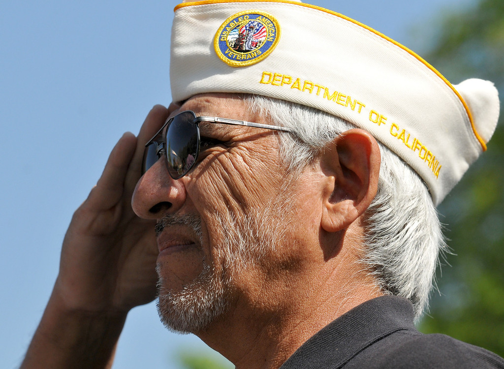 Description of . (John Valenzuela/Staff Photographer) Commander for the San Bernardino Disabled American Veterans (DAV) Chapter 12, Richard Valdez, salutes the flag during the singing of the national anthem, Saturday, during the start of the groundbreaking ceremony for the Veterans Living Memorial Garden, at Cal State San Bernardino, March 23, 2013. The non-profit organization Incredible Edible Community Garden of Upland, donated 50 trees for newly designed Veterans Living Memorial Garden, outside the Veterans Success Center.